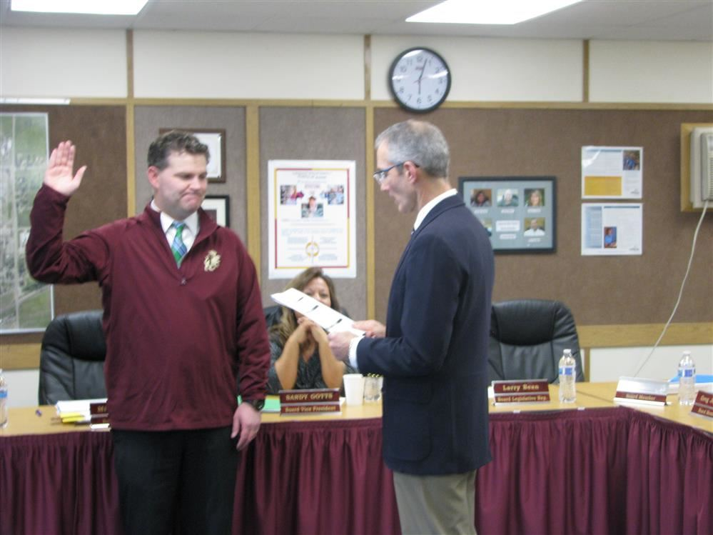 New board member Jeremy Toponce sworn into office